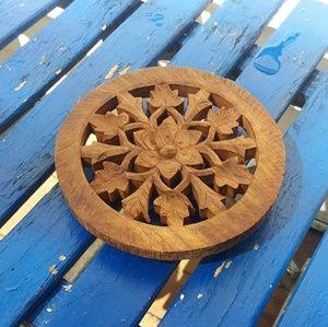 Floral Wood Carved Trivet made in India.